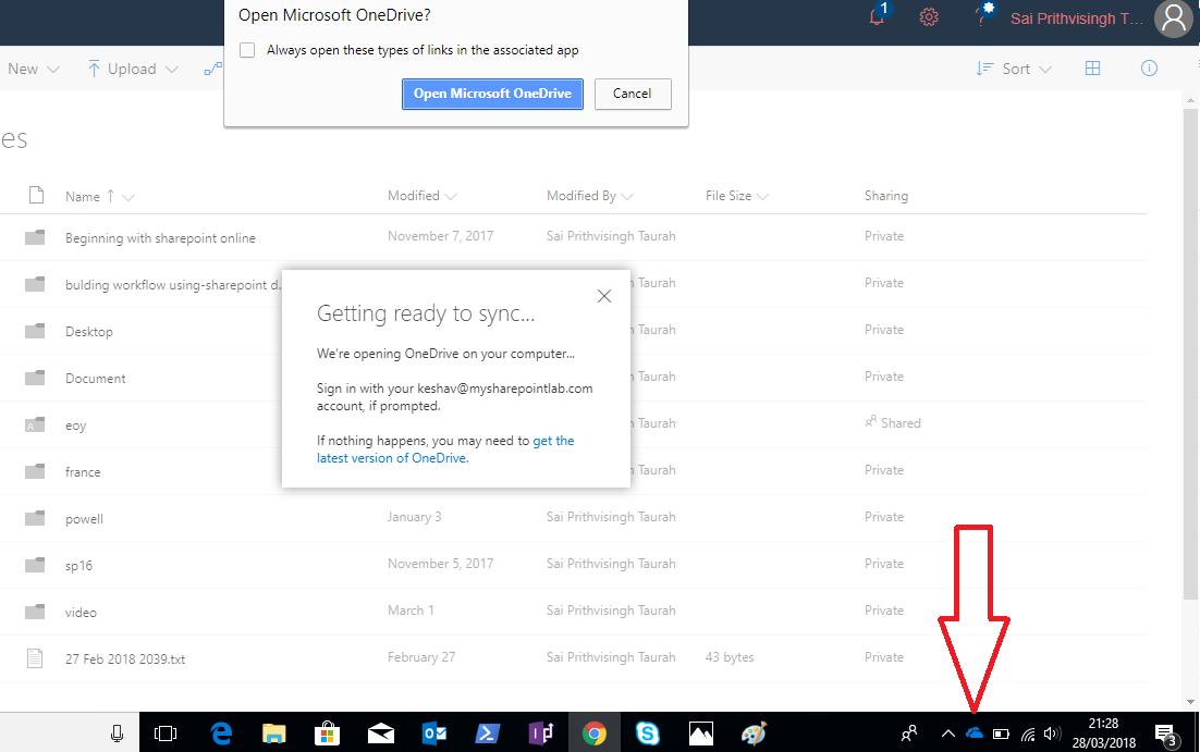 Locate the OneDrive symbol in the system tray area