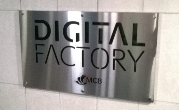 Door sign of the Digital Factory, 4th floor at Harbour Front building, Port Louis